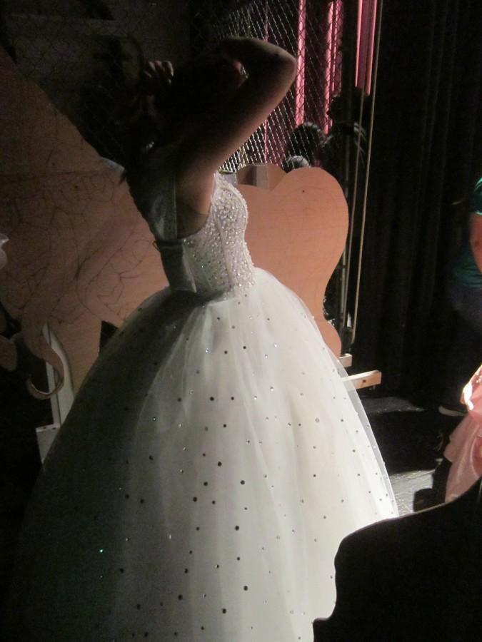 Cinderella prepares backstage as she waits for her cue.