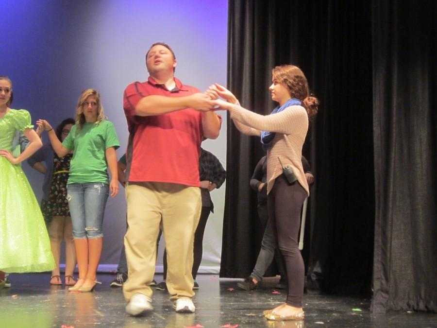 Mr. Pica shows Halle Forbes the proper way to dance.