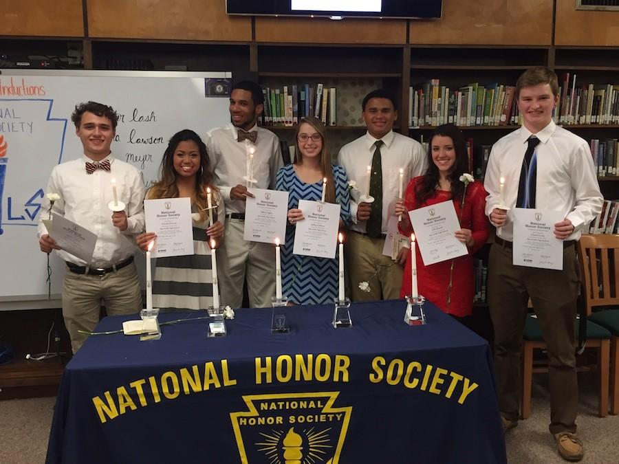 Inductees Matt Strehle, Eleesha Ducusin, Myles Goggins, Ashley Claiborne, Jesse Meyer, Lexi Russell, and Chase Condor show off their certificates and candles after the ceremony.
