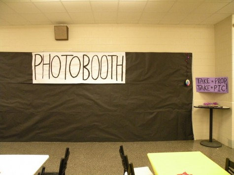 "A ""Photo Booth"" is laid out as a backdrop to take pictures in front of"