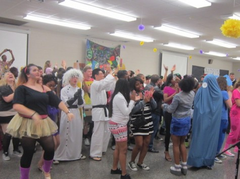 Seniors dance to the Cha Cha Slide on the dance floor