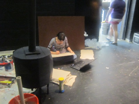 Backstage crew helps create scenery for the stage