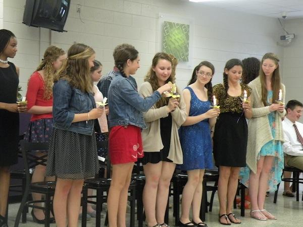 French NHS inductees light candles
