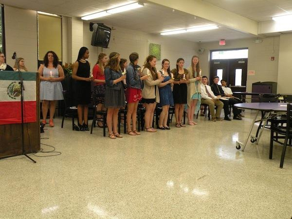 French Honor Society inductees light candles and say their pledge