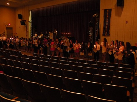 NHS Inductees light candles in tradition