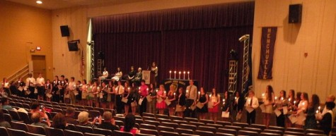 Inductees line up for a group picture