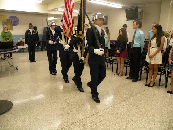 JROTC Color Guard presents arms and flag
