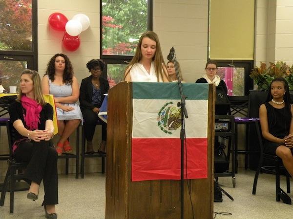 Spanish Honor Society member Sarah Scott giving regards to future members