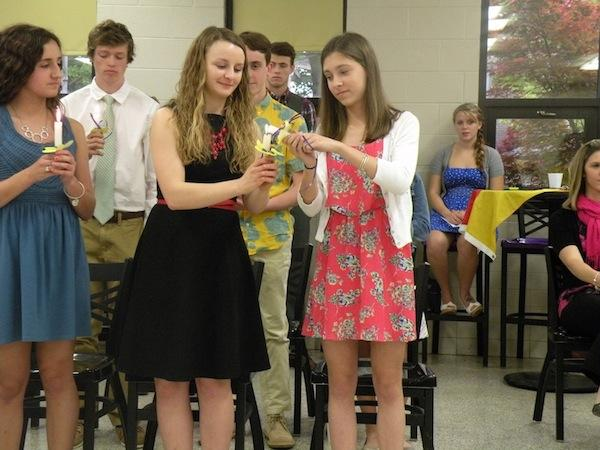 Spanish Honor Society inductees light ceremonial candles