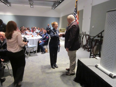 Cadet Taylor Pobiak receives an award and scholarship from visiting veterans