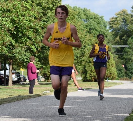 Cross Country runner Evan Isham, pushing to get to the finish line.