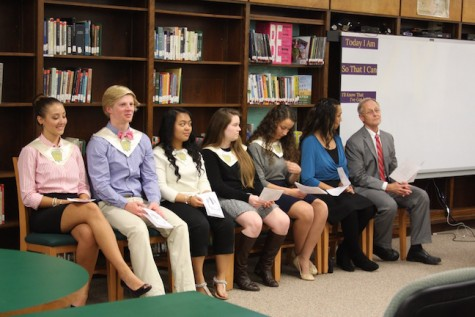 The National Honor Society officers, Mrs. Banks and Mr. Surry sit and wait to start the ceremony.