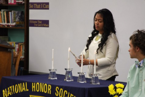"Candles are lit by Honor Society officers to symbolize the motto of the Honor Society: ""Character, Scholarship, Leadership and Service""."