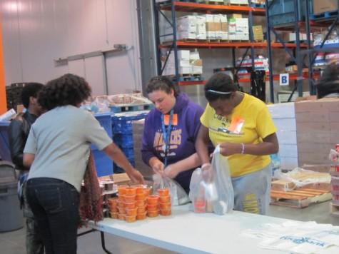 Alexia parker, Izzy Buckhanon, Allison Nuckols, and Kenya Buckhanon hard at work bagging food.