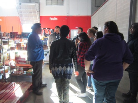Group receiving information about the culinary program at the Food-Bank.