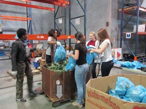 Menchvilles L2F volunteers hard at work bagging mixed greens.