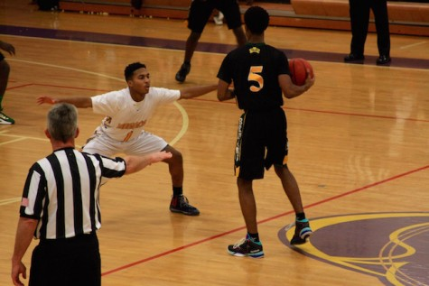 Senior Daryl Barbour attempts to block a Bruin from coming down the court.