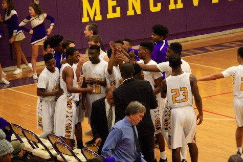 The Monarchs rally during a break in the game.