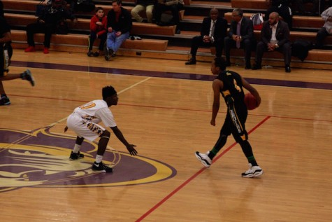 Senior Mike Jones attempts to block a Bruin coming down the court.
