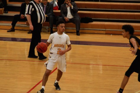 Senior Kenneth Turner has possession of the ball and looks for a pass to one of his team mates.