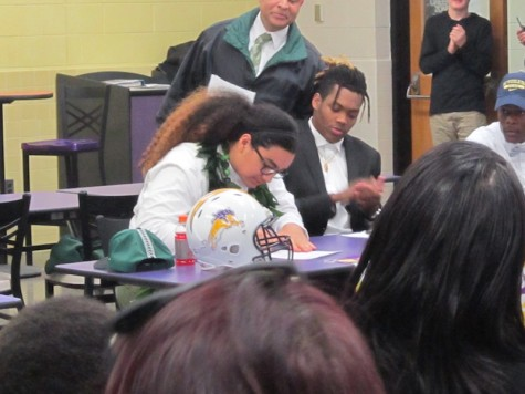 Kalepo Naotola signs his letter of intent to play collegiate football for Hawaii University.