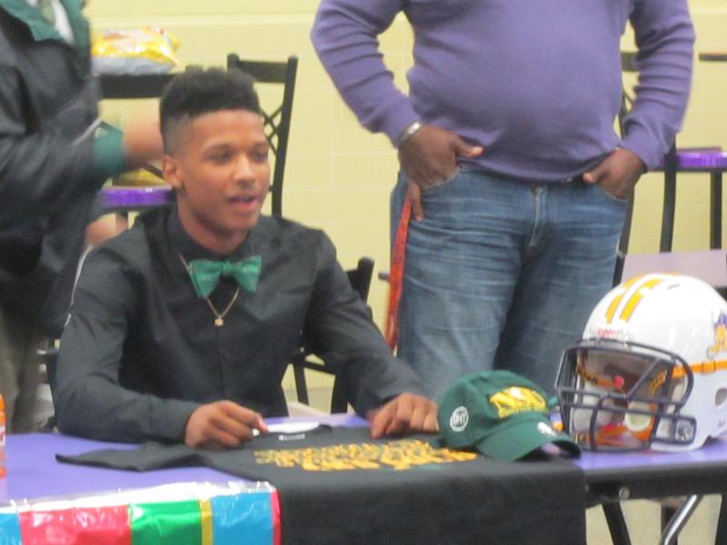 Malik Dixon signs his letter of intent to play collegiate level football for Norfolk State University.
