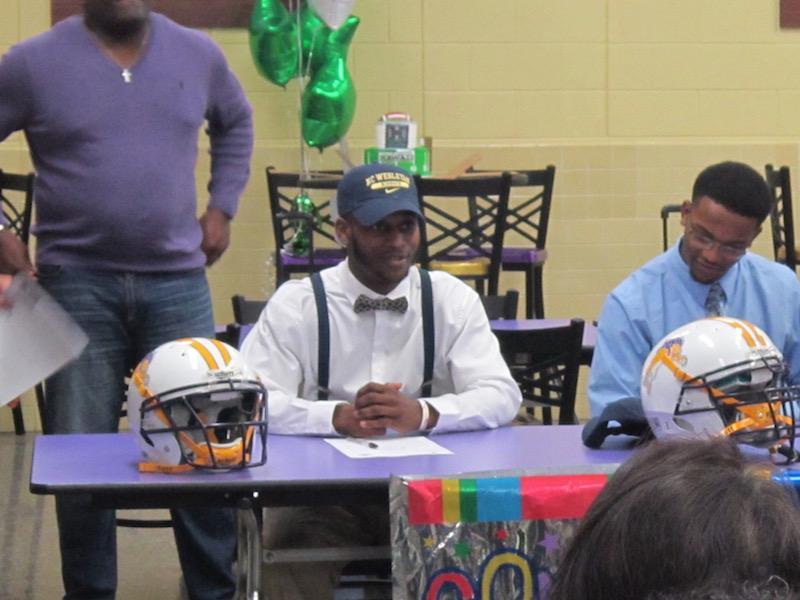 Torey Guilford signs to play collegiate football at North Carolina Wesleyan College.