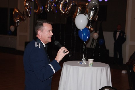 Colonel Alden begins with opening remarks before the dance begins.