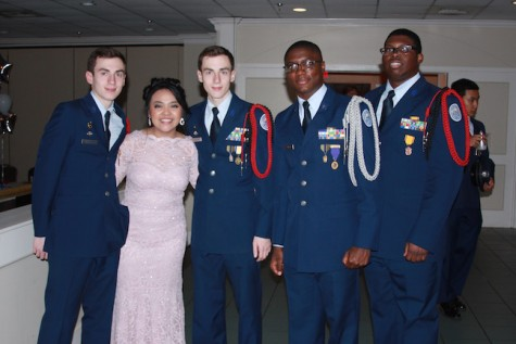 4th years Austin Reynolds, Denica Obis, Brent Reynolds, Kha'darryl Johnson, and Malik Faulkner smile for a picture.