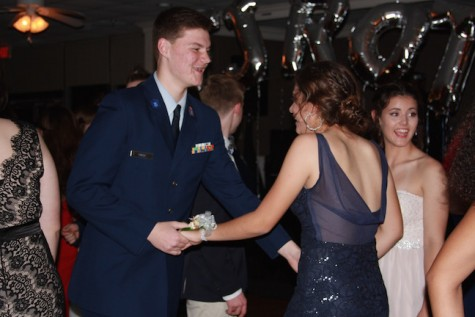Guests enjoy a time filled with dancing and fun before ROTC court, king and queen are announced.
