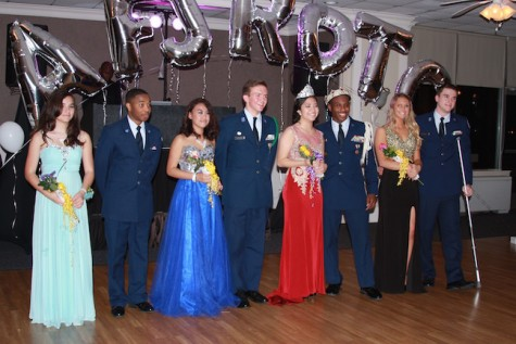 ROTC court, King and Queen smile for a group photo.