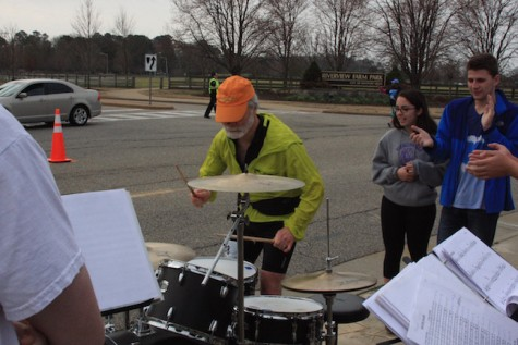 One runner stops by to show the band how it's done with his drum skills.