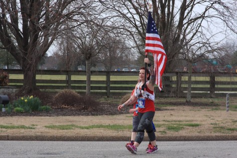 Since the runner was carry an American Flag on her run, it was only right that the band play the National Anthem while she passed by.