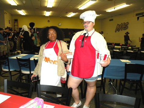 "Maya Fisher & Taylor Moore as ""Popeye"" and ""Colonel Sanders'"