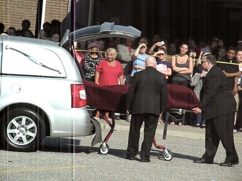 """Deceased"" Kayla Paxton being loaded into a horse by Newport News Coroner"
