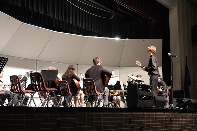 Junior Noah Nipp conducting the Intermediate Ensemble