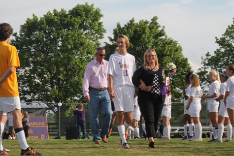 Senior, Taylor Fitzgerald was escorted by his parents and brother, Ian Fitzgerald.