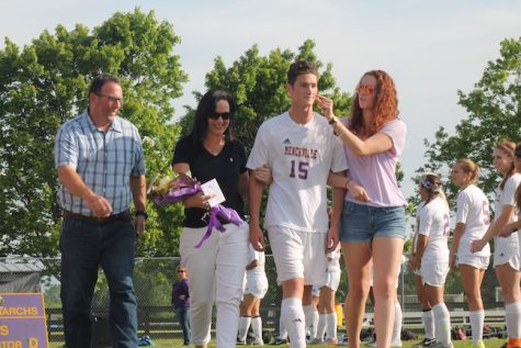 Senior, Cole Montgomery was escorted by his parents and sister.