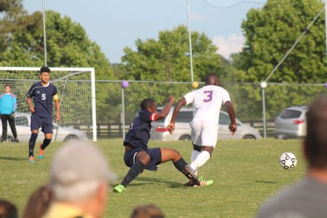 Senior Tre Bagby gains possession and advances down the field.