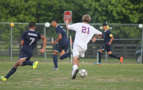 Senior Taylor Fitzgerald gains possession of the ball.