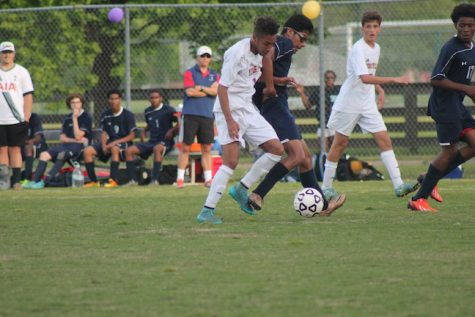 Senior Giovanni Zagursky attempts to get the ball from the Patriots.