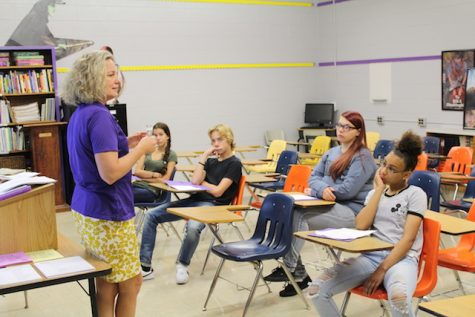 Mrs. Carneal welcomes her Journalism 1 class.