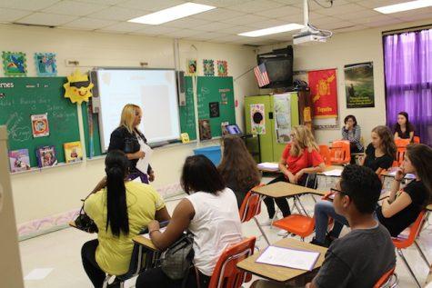 New Teacher, Mrs. Rodreiguez, welcomes her class.