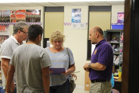 Mr. Traner discusses with parents.