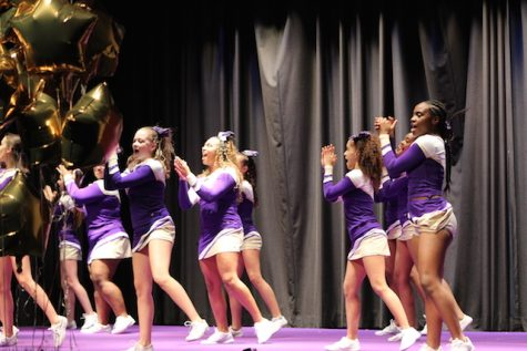 Menchville's cheerleaders take the stage.
