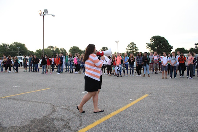 Allison Nuckols leading students in a Privilege Walk activity