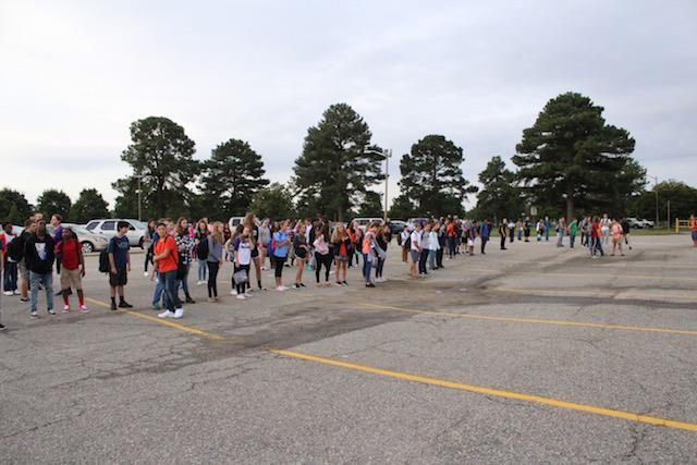 Students participating in a Privilege Walk activity