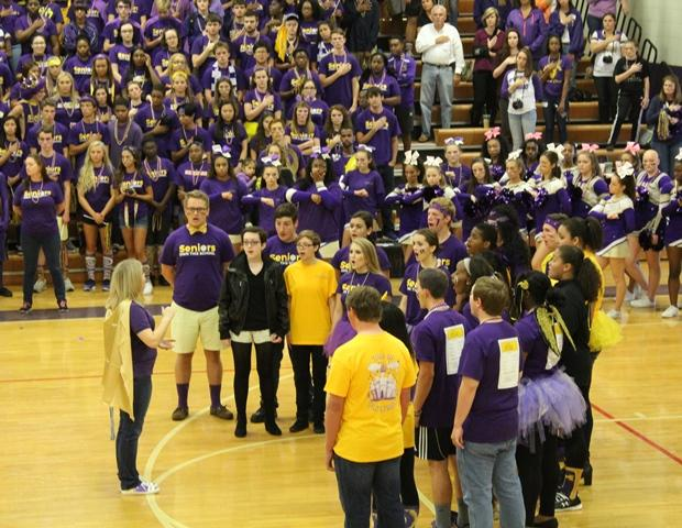 Students in the Menchville Choir department sing the national anthem to start off the pep rally.