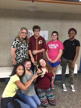 Stephanie Cooke shares her Emmy with 9th grade students