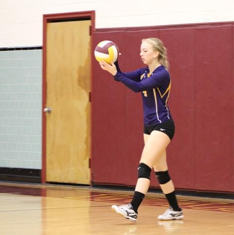 Mackenzie Swetnam prepares to serve